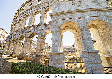 A fragment of wall of antique Roman amphitheater in Pula - A...