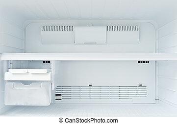 A freezer - An empty freezer of a refrigerator