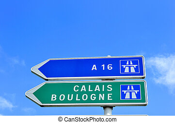 A French road sign pointing the way to Calais and Boulogne, two famous channel ports for ferry travel to the UK.  Copy space above.
