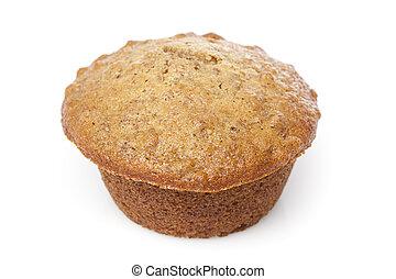 A fresh bran muffin against a white background