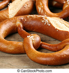 German Pretzel on a wooden table - A fresh German Pretzel on...