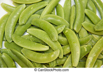 fresh organic Snow Peas on plate