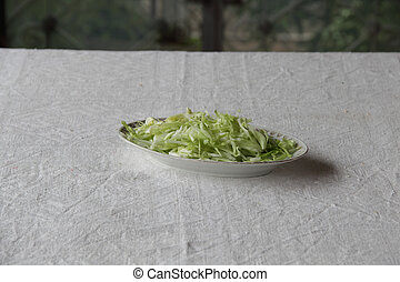 a fresh salad in plate on table