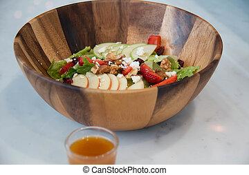 Fresh vegetable salad in wooden bowl