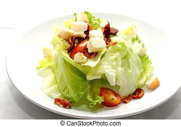 Fresh vegetable salad on white plate