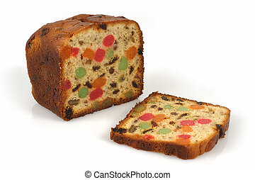 A freshly baked isolated loaf of candied Christmas fruitcake.