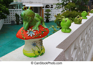 a frong doll decorated in the garden