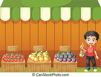 A fruit shop with a young boy wearing a red shirt