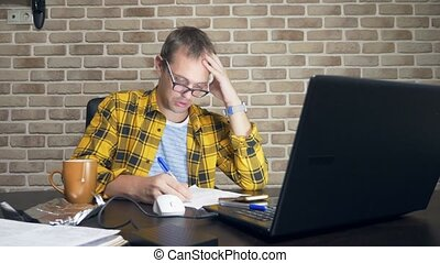 a frustrated man cannot concentrate, having a block of...