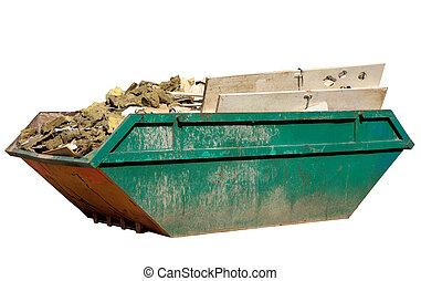 A full skip. - A skip full of building materials rubbish ...