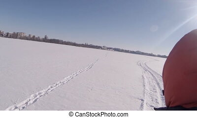 A fun ride on a snowmobile on a frozen river