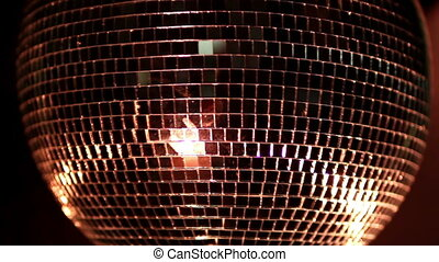 a funky discoball spinning and reflecting light. perfect clip for club visuals or party/celebration