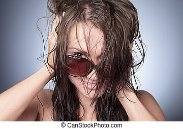 A funny sun glasses woman with gray background