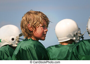 a game well played - a teenaged boy stands on the sidelines...