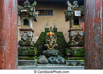 A Ganesh statue in a courtyard in B