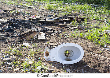 a garbage dump - old toilet at large garbage dump in the ...