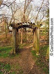 A Garden Arch in the woods of a park in Suburban Pennsylvania