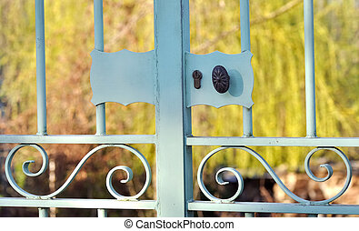 a garden gate - lock and handle of a garden gate closing