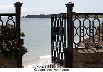 A gate opening up to a sea view