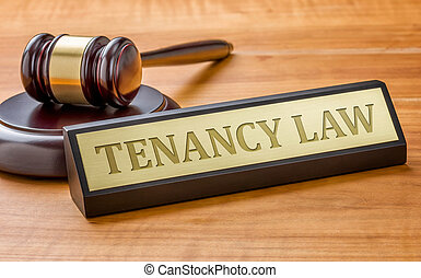 A gavel and a name plate with the engraving Tenancy Law