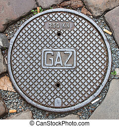 A gaz manhole cover - Manhole cover with cigarette butts