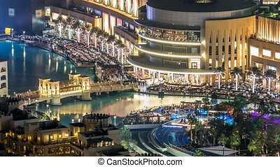 A general view of the bridge over man-made lake timelapse in Dubai downtown, United Arab Emirates.