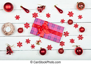 A gift for the new year - a box tied with a red ribbon.