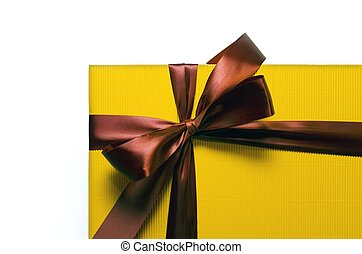 Yellow present with a red ribbon on a white background