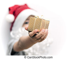 A gift in the hand of a child, dressed as Santa Claus, close-up