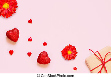 A gift on a pink background with decorations. The concept of the weddings, engagements, birthday and other holidays.