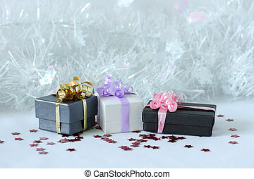 gifts with shiny bows on a Christmas party decor