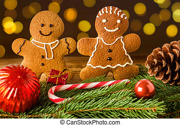 A gingerbread couple with christmas decorations