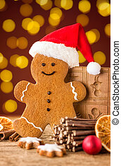 A gingerbread man with a hat and christmas decorations