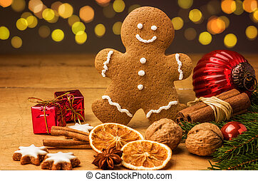 A gingerbread man with Christmas decorations