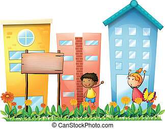 A girl and a boy in the garden with a wooden signboard