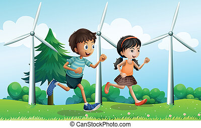 A girl and a boy running in the hill with windmills