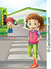 A girl and a young boy near the gasoline station