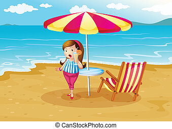 A girl at the beach with an orange juice