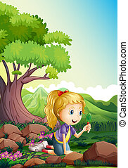 A girl at the forest holding a shovel