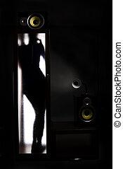 A girl behind the glass door