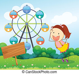 A girl beside an empty board with a ferris wheel at the back