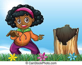 A girl beside the stump