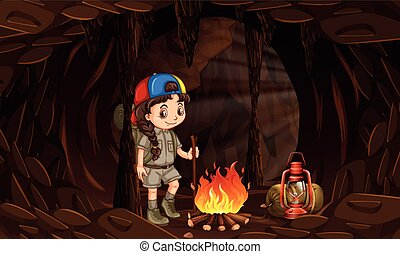 A girl camping in the dark cave