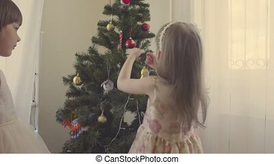 A girl decorating christmas tree