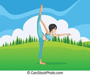 A girl doing yoga across the pine trees