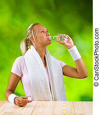 a girl drinking water from bottle