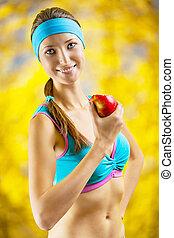 a girl eating an apple