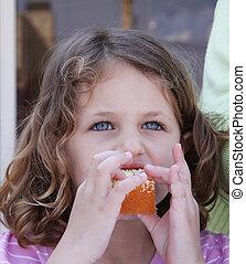 a girl eating birthday cake