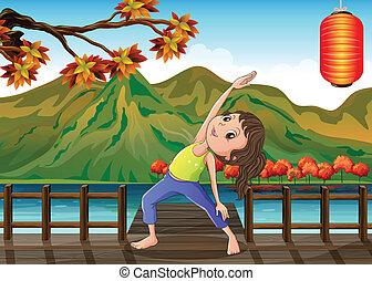 A girl exercising at the bridge with a lantern -...