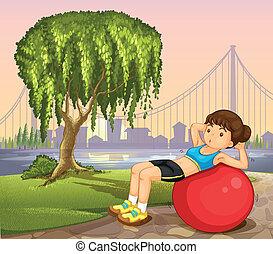 A girl exercising near the river